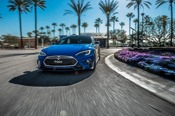 Unplugged Performance Tesla Model S Full Front Fascia System in dry carbon fiber rolling shot