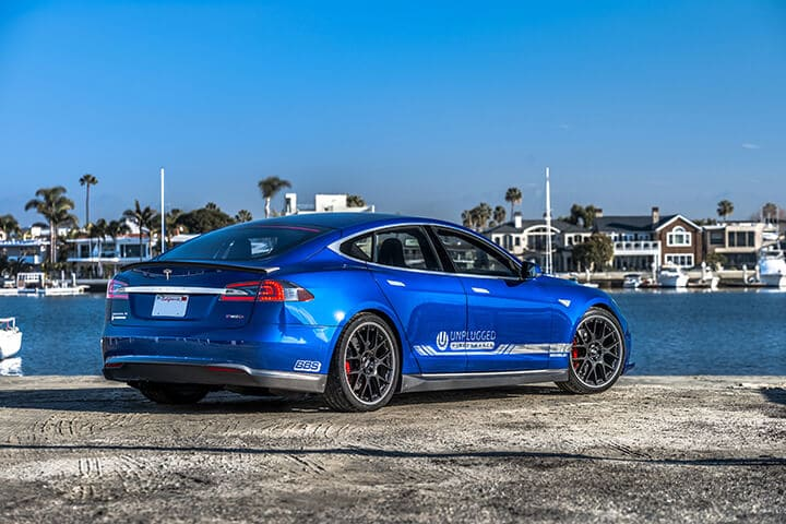 Unplugged Performance Rear Under Spoiler and Diffuser System for Tesla Model S - Blue Carbon Fiber Rear 3/4 View