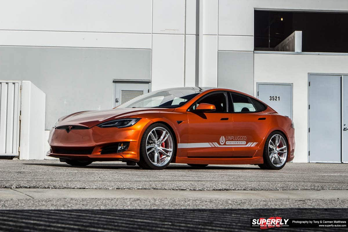 Unplugged Performance Orange Tesla Model S P85+ Demo Car